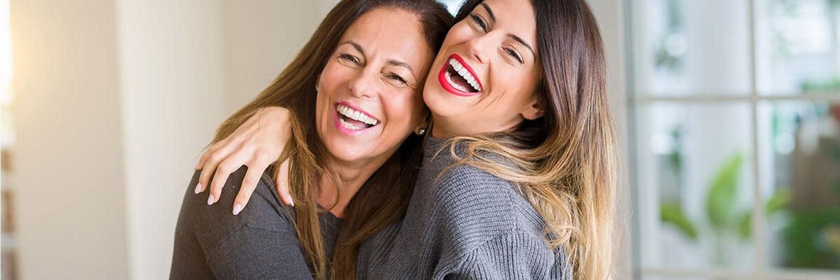 Mother-And-Daughter-Hugging-Lauging